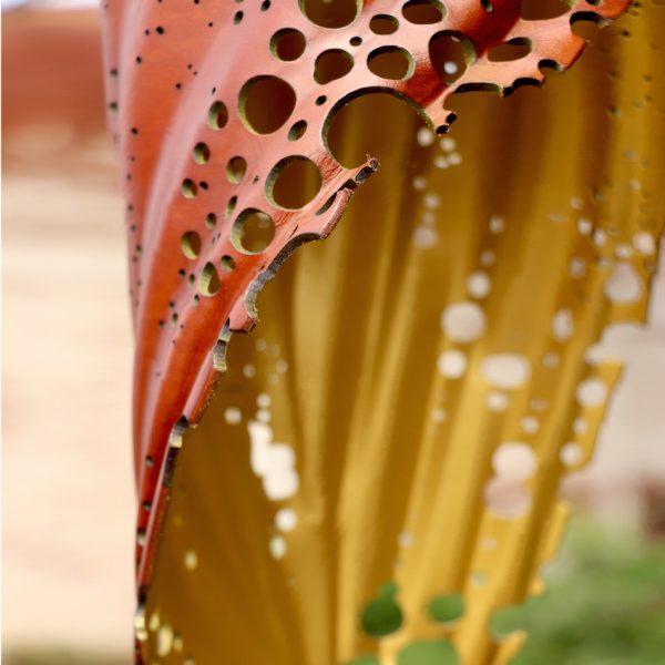 7.1 tan:gold pierced blade close up copy